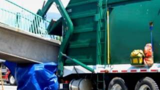 Garbage truck strikes overpass, driver crushed
