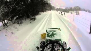 John Deere 1025r - plowing snow