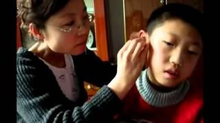 Chinese Ear Cleaning (60) A mother cleaning her son's ears
