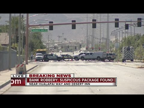 Officers investigating bank robbery involving a suspicious package