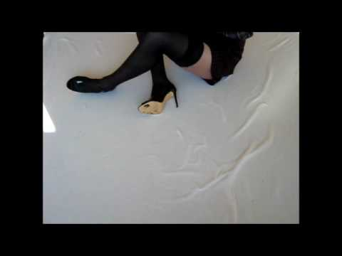 Short skirt, stay up stockings and high heels