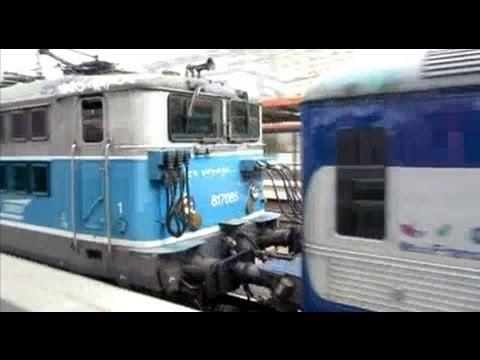 France: SNCF Electric class 17000 locomotive departs Paris Gare du Nord passing a 9 car Z6100 EMU