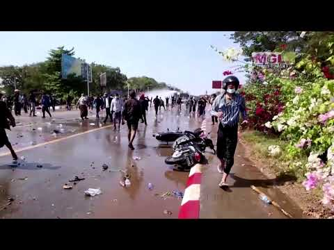 Myanmar police fire into the air, use water cannons