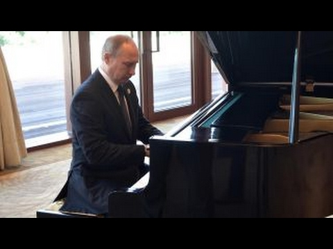 But does he know 'Chopsticks'? Putin shows off piano skills