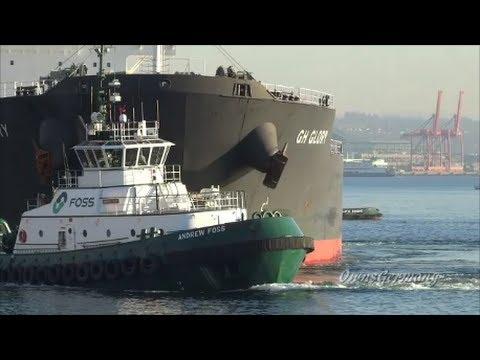 Foss Tugs Push Out Bulk Ship in Elliott Bay