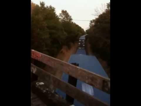Train traveling under Thunder Bridge on Monkey Road, Athens