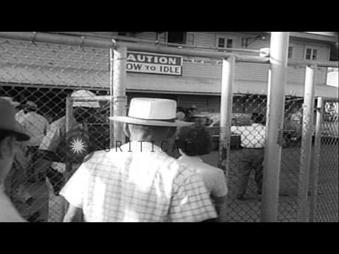 Cubans get off from a boat and enter a building at Guantanamo Bay Naval Base in C...HD Stock Footage