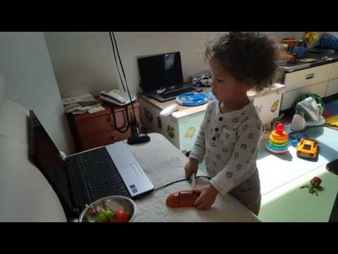 18 months baby playing with play knife cutting food fruit bread(2)