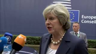 Theresa May attends her first EU summit in Brussels