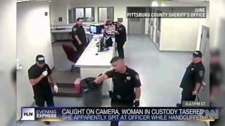 Cop uses Taser on handcuffed woman, Police Brutality