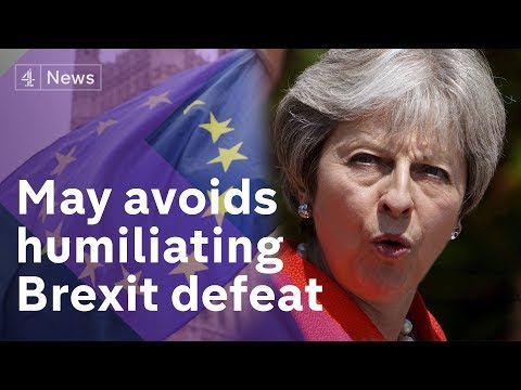 May's Brexit plan on knife-edge as defeat avoided by 6 votes