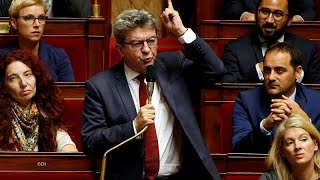 Raw Politics: French left leader Jean-Luc Mélenchon reacts angrily to police raids