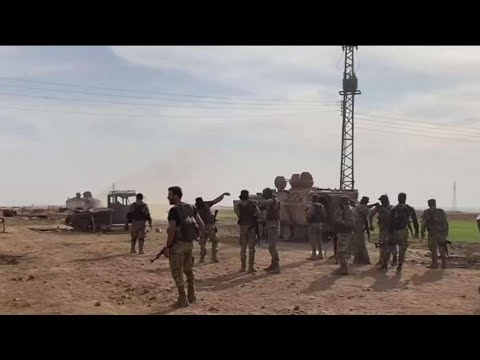 Fierce fighting rages over key Syrian border town