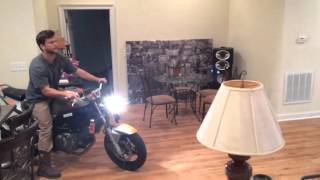 Fail: Idiot tries to wheelie motorcycle in house