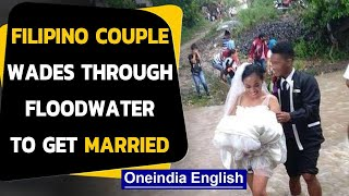 Filipino couple wades through floodwater to get married, pics go viral|Oneindia News