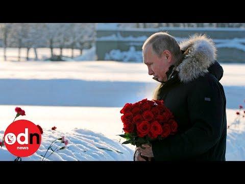 Vladimir Putin lays flowers at the Leningrad memorial