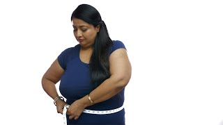 Upset Indian woman measuring her belly fat and looking fed up - Health Issues