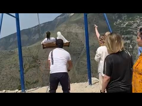 PLUNGE HORROR Terrifying moment 2 women fall off swing on the edge of 6000ft cliff when chain snaps