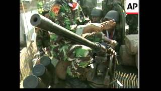 Troops mass as martial law imposed