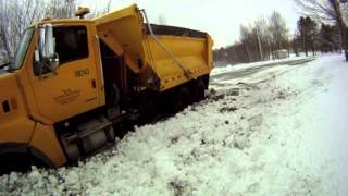 Heavy Snow Shoves Plow Truck into Ditch