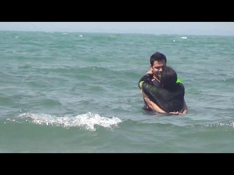 Couple Enjoy Bathing At Sea Beach