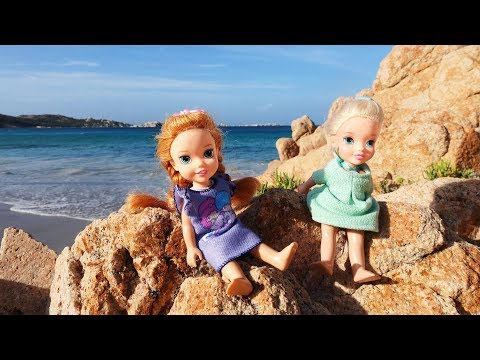 Elsa and Anna toddlers at the beach