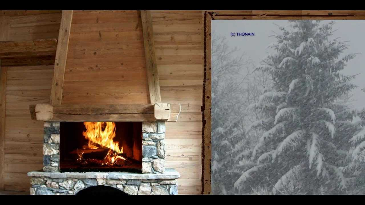 feu de cheminee qui crepite dans un chalet sous la neige. Black Bedroom Furniture Sets. Home Design Ideas