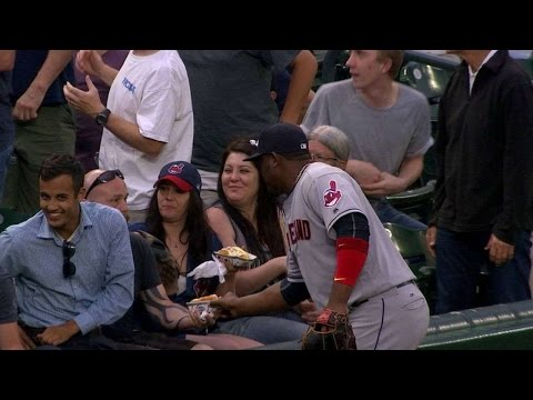 Uribe pretends to go for a fan's hot dog