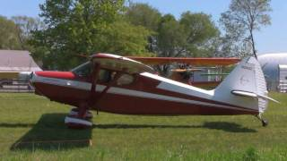 1947 STINSON VOYAGER TAKING OFF GRASS FIELD