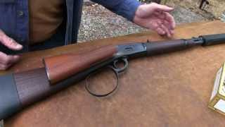 leveraction rifle with suppressor