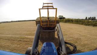 Clearing Hay In The Field (Bale Band It Packs)