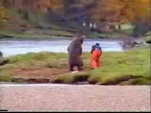 bear vs man over fish who will win?