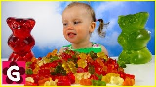 Kid playing with Giant Gummy Bear Candies