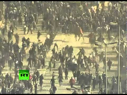 Camels & horses storm into Tahrir Square as protesters clash in Cairo