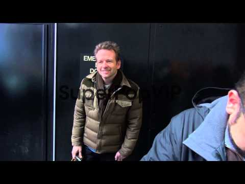 Dallas Roberts poses with a  outside in New York, NY, ...