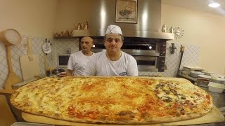 The biggest pizza in the world 🌎 you'll find it in Correggio Restaurant Pizzeria Infinity