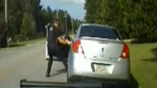 Woman Drags Police Officer With Car