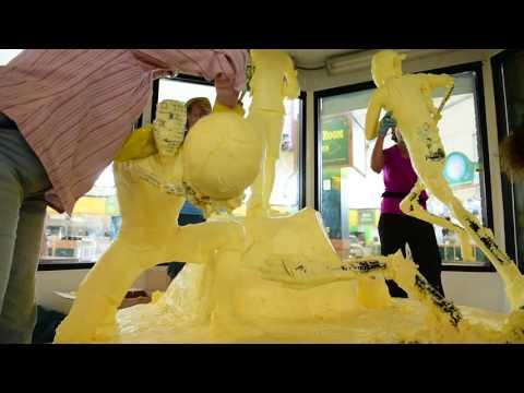 Watch 800 lbs of butter sculpture get dismantled