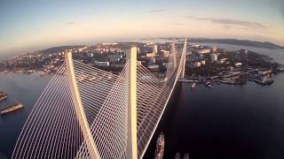 Episode 1: First VLADIVOSTOK FPV quadcopter flight  / Полеты на вертолете над Владивостоком (HD)(My city of origin Vladivostok became more beautiful after APEC summit. New Golden and Russkiy bridges. City center, Lighthouse and yachts. THANKS TO ALL ..., 2013-09-21T12:39:34.000Z)