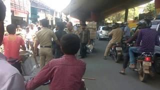 Police beating person near market bangalore