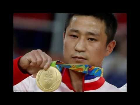 North Korean gymnast looks unhappy when taking gold in the gymnastics
