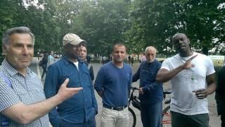 Hyde Park Hamid and Sa Ra having a short discussion.