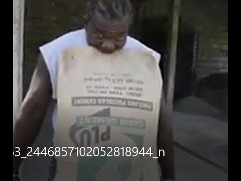 JAMAICAN MAN LIFT UP  BAG OF CEMENT WITH TEETH