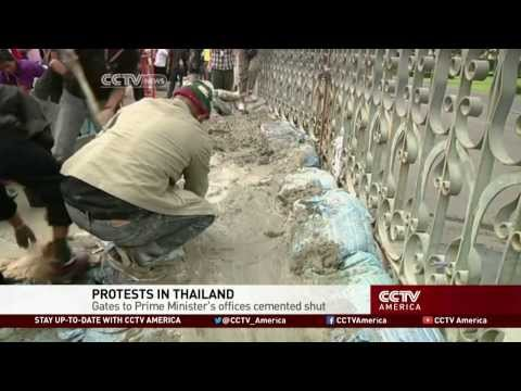 Thailand Protesters Cement Government House Gates