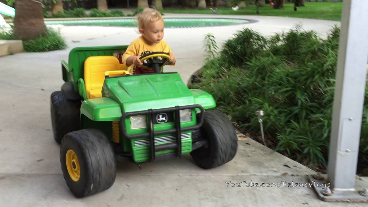 Old John Deere Power Wheels : Year old driving in high speed cadillac escalade™ and