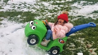 Sally drive and crash Disney ride on cars in the snow