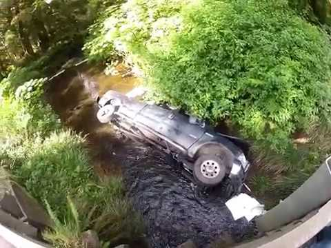Ford 4x4 Rollover  into guardrail and creek