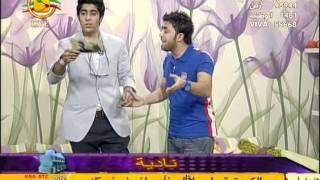 مذيع كويتي يلبس العلم الامريكي ... وفي رمضان !!!!!