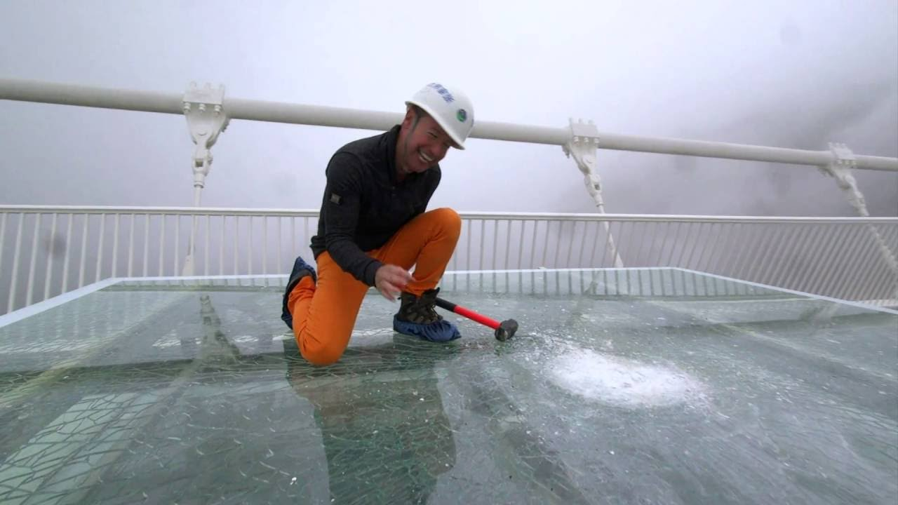 Download China's giant glass bridge hit with sledgehammer - BBC Click