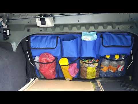 Чехол с карманами на спинку багажника.